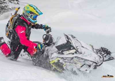 Professional snowmobile riders on smowmobile