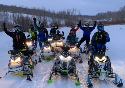 Group of people on snowmobiles