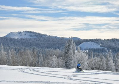 One snowmobile rider on a snow covered mountain trail in Steamboat Springs, CO